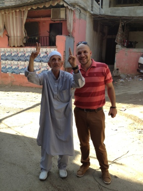 Odeh poses for a photo with a camp elderly - Burj El Barajneh Beirut